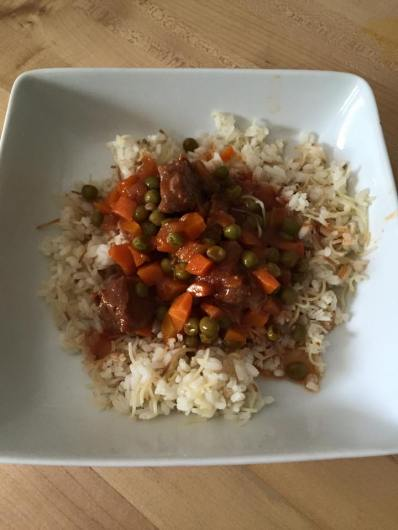 Egyptian recipe of beef stew with peas and carrots
