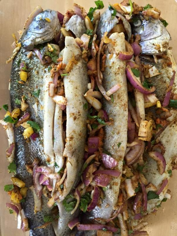Trout fish with onions, bell peppers, garlic, cilantro and spices.